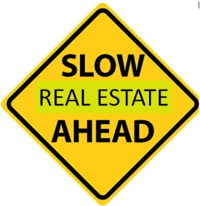 slow real estate ahead sign